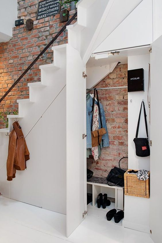 Use the space under the stairs of your tinyhouse to gain a bit of space